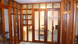 Wood and glass partitions and glazed doors for lounge and hall -includes exquisite coloured glass