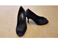 Black material peep toe shoes