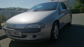Silver Vauxhall Tigra with only 84k miles on the clock.