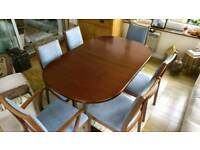 Mahogany, extendable dining table and 6 chairs