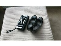 black paton shoes and clutch bag.
