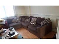 Brown corner sofa - splits into 4 sections