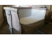Chicco next-to-me Crib for sale. Good condition. Comes with mattess, fitted sheet and 2 flat sheets.