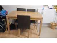 Dining table and brown leather chairs
