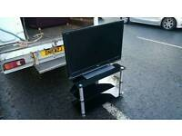 Toshiba black flat screen Tv and cabinit £110 delivered