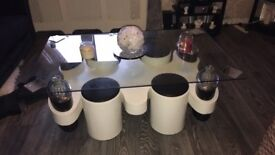 Black white and glass coffee table with 4 stools