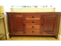 Solid wood sideboard in a rich reddish brown colour