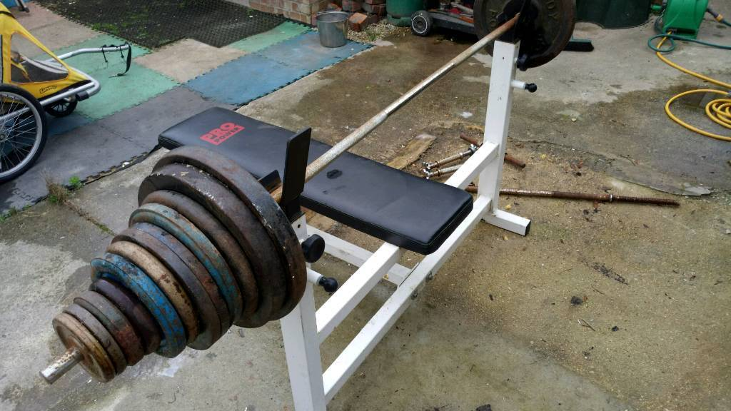 160 kg Weights, bars, and bench