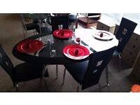 EXCELLENT CONDITION!!! As new glass dining table and 4 chairs