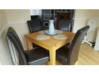 Extendable Oak Table & 6 Black Faux Chairs