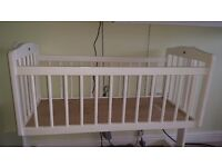 Lovely white rocking crib