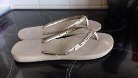 Women's Gold Havaianas flip flops