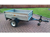 Bigmak galvanised trailer with fold down tail gate, jockey wheel and water proof cover.