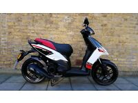 Aprilia SR Motard 125 2014 with helmet 125cc scooter