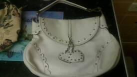 Lovely handbag with hanging hearts