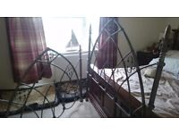 Solid cast iron bed frame with springs