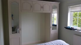Overhead bedroom wardrobes cream