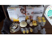 medela breast pump with bottles and accessories. hardly used.