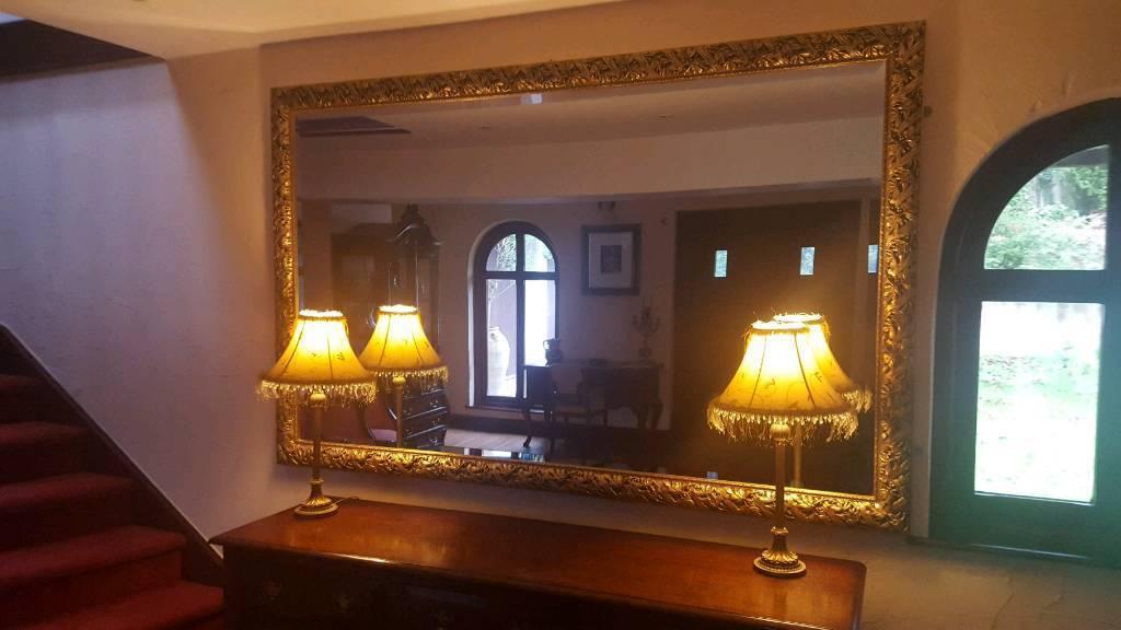 Large gold framed bevel edge mirror