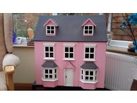 Dolls House with furniture on moveable stand