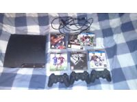 PS3 for sale with controllers and few games
