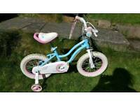 Girls first bike with stabilizers