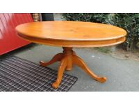 Solid Pine, single pedestal, oval dining table. Excellent quality. Very solid. Antique pine finish.