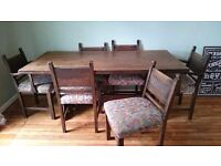 Lovely dark oak dining table and 6 chairs
