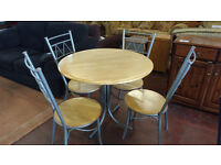 Circular metal framed bistro/dining table with 4 chairs (delivery available)