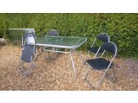 Glass Top Table And 5 Folding Chairs