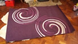 Purple and cream patterned rug. Slightly used but not worn (6 years old)