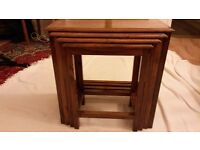 LATE 20TH CENTURY NEST OF FOUR TABLES - TEAK WITH BRASS INLAY