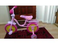 Girl's pink tricycle