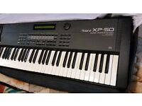 ROLAND XP 50 KEYBOARD WITH MANUAL.