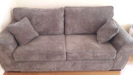 3 seater sofa in grey fabric.
