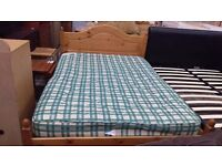Pine double bed frame with checkered mattress