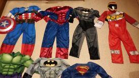 Assortment of kids superhero costumes