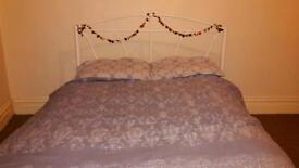 Ornate cream metal double bed
