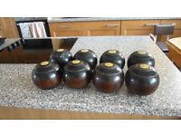 Wo Bowls Two sets of wood bowls.