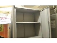 2 X LOW BISLEY CUPBOARDS WITH A SHELF IN GREY COLOUR IN USED BUT GOOD CONDITION.