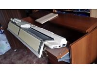 Brother electroknit KH950i knitting machine with cabinet need to sell as need space