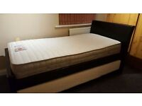 Single faux leather guest bed with quality mattresses