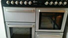 Duel fuel double cooker with cooker hood and steel splash back