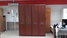 Lovely double wardrobe dark wood.