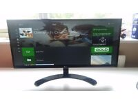 LG 29 inch ultra-wide gaming monitor. With built-in speakers.