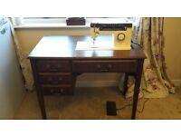 Classic Singer sewing machine in original cabinet