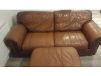 Brown leather sofa and large footstool