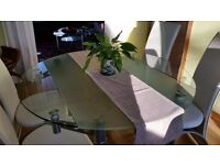 Modern Glass dining room table adjustable size with four cream leatherette chairs