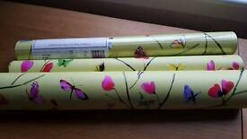 1 unopened roll wallpaper lime/multi Coloured butterflies and around half roll opened wallpaper