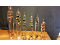 Six Glass Thermometers.
